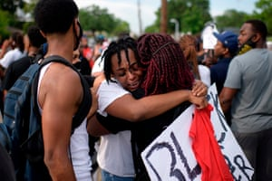 George Floyd's niece Gabrielle Thompson cries as she hugs another woman during a Justice for George Floyd event on Saturday in Houston
