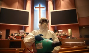 A coronavirus disinfection worker sprays anti-septic solution in a Yoido Full Gospel church in Seoul, one of the biggest churches in South Korea.