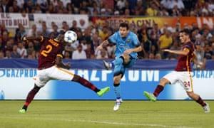 Barcelona's Lionel Messi fires a shot past Roma's Antonio Ruediger, left, and Alessandro Florenzi.