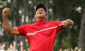 Tiger Woods celebrates after sinking his putt on the 18th that won a fifth Masters at Augusta National.