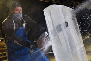 Alex Greenhalgh takes a chainsaw to a block of ice as he creates an ice sculpture which will make up part of a forthcoming exhibition