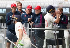 England's Jos Buttler is congratulated by captain Joe Root (left) and coach Graham Thorpe at the end of day one.