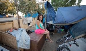 Michelle, resident of the Santa Ana River bike trail homeless encampment, beside her tent on 6 September.