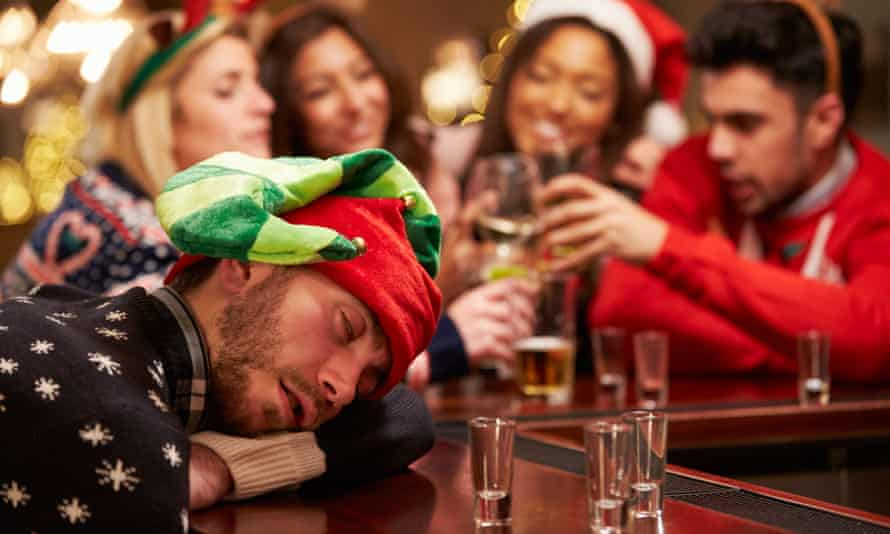 VARIOUSMandatory Credit: Photo by Monkey Business Images/REX/Shutterstock (5139308a) MODEL RELEASED Man Passed Out On Bar During Christmas Drinks With Friends VARIOUS