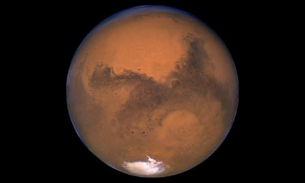 Snapshot of Mars taken by the Hubble space telescope 11 hours before the planet made its closest approach to Earth on 26 August 2003.
