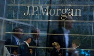 People walk past JP Morgan's office