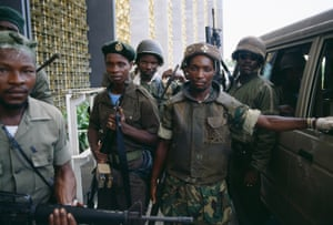 """Colonel Michael Tilly, right, leader of the """"Death Squad,"""" a faction of President Samuel Doe's Armed Forces of Liberia, with his troops in Monrovia."""