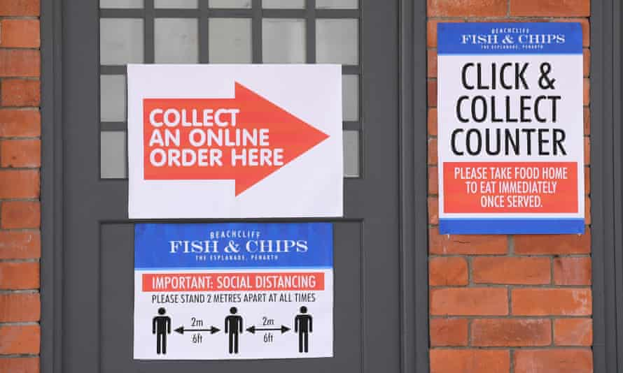 Social distancing signs at Beachcliff fish and chip shop in Penarth, Wales.