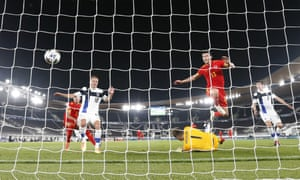 Kieffer Moore of Wales opens the scoring from close range.