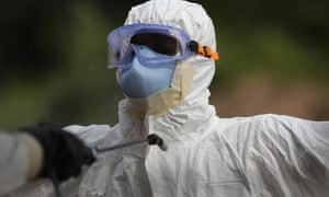A burial team member wearing personal protective equipment in Liberia. A report prepared in October identified three scenarios for the exploitation of Ebola for bioterrorism.