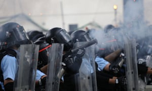 """Police fire another tear gas round at protesters, as Hong Kong's police commissioner called the protest a """"riot"""""""