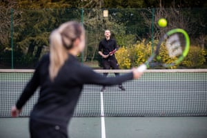 Friends Joe Seakins and Lucy Bailey catching up over tennis in Cannon Hill Park in Birmingham
