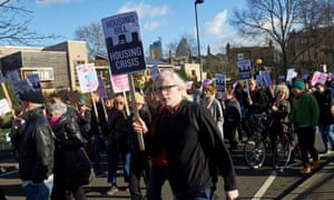 Protesters march against the housing bill during a demonstration in London in January.