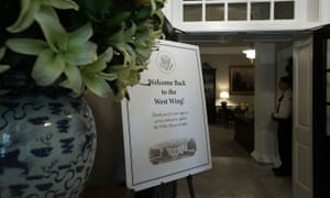 A welcome sign is seen at the entrance of the West Wing.