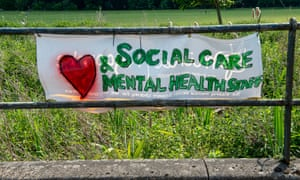 A sign in support of social care and mental health workers hung in High Wycombe in May.