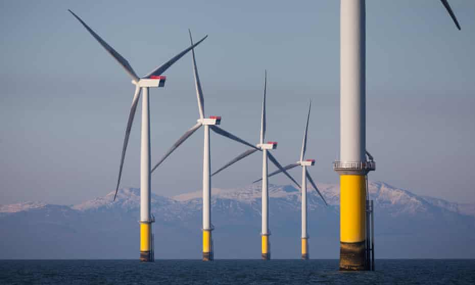 Wind turbines of Walney and West of Duddon Sands Offshore Wind Farm near the Lake District.