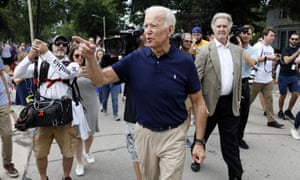 Joe Biden greets local residents in Independence, Iowa, on 4 July.
