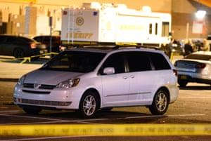 A minivan is taped off by police at a parking lot of a Home Depot in Passaic New Jersey.