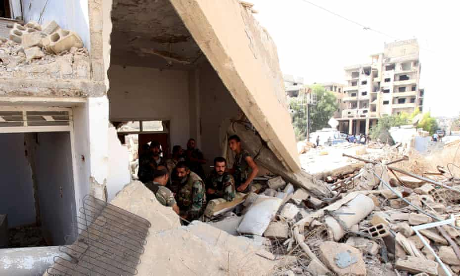 Soldiers in the besieged town of Daraya