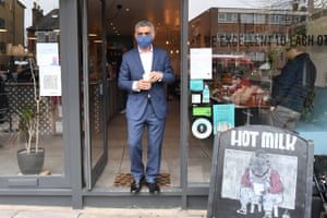 The mayor of London, Sadiq Khan, has a drink from the Hot Milk cafe in north London, UK