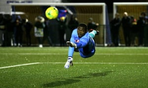 Haringey Borough goalkeeper Valery Pajetat dives for the ball during the FA Cup qualifying replay against Yeovil.