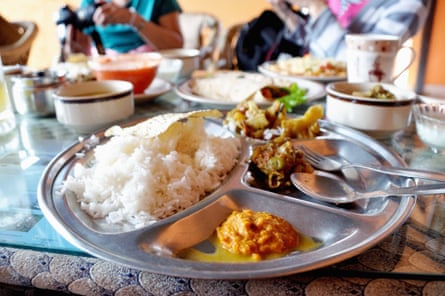 Dal Bhat, traditional Nepali meal platter with rice, lentils soup, vegetables, poppadum and spices.