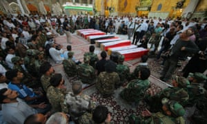 Coffins of 10 Iraqi soldiers killed in June 2014 by Islamic State militants
