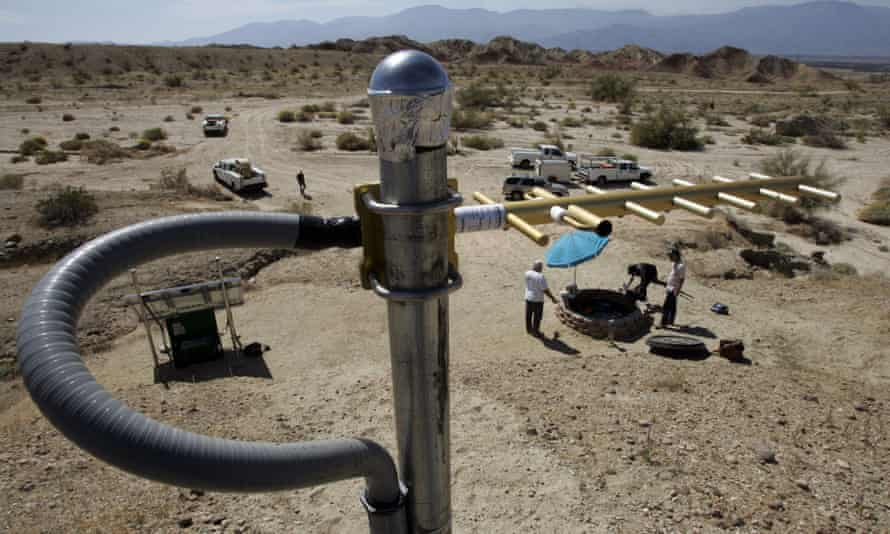 An antenna to send data stands on a rise above an earthquake monitoring well, right, powered by a solar electric panel, lower left, as scientists from the US Geological Survey set up an earthquake monitoring station on the San Andreas fault.