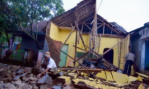 People inspect the ruins of a house in Tasikmalaya in West Java after an earthquake.