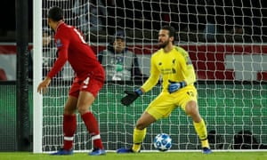 Liverpool's Alisson reacts after being wrongfooted by Juan Bernat's shot which gives PSG the lead.