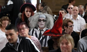Witches and a man dressed as Beetlejuice (centre) attend the Halloween-themed funeral of Lorna Johnson at Luton crematorium.