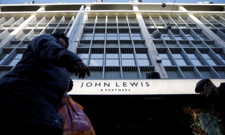Shoppers walk past the John Lewis department store on Oxford Street.