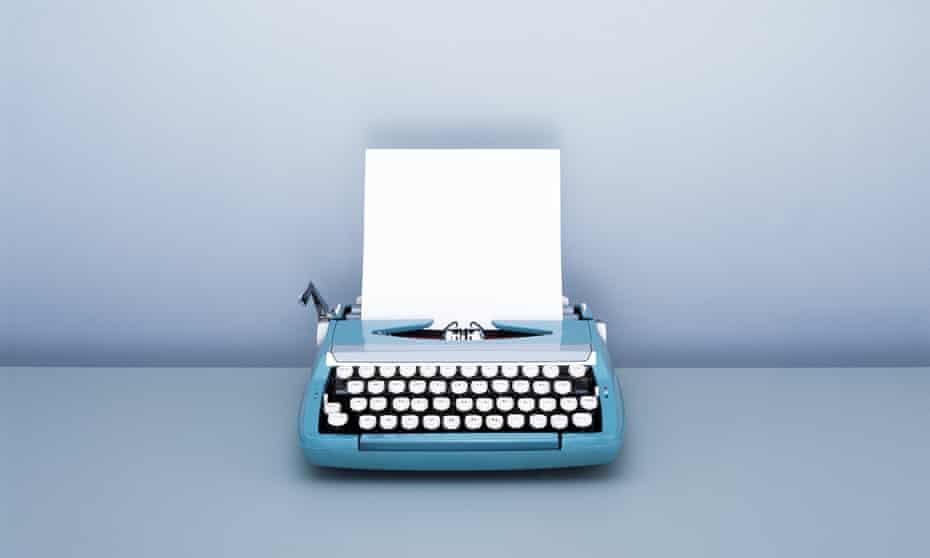 Sheet of blank paper in Typewriter on desk