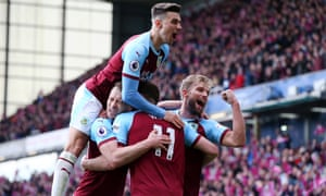 Chris Wood (no 11) is congratulated by his teammates as they celebrate after he scored his, and Burnley's, second goal of the game.