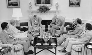 President Ford (centre right) in the Oval Office with the Olson family.