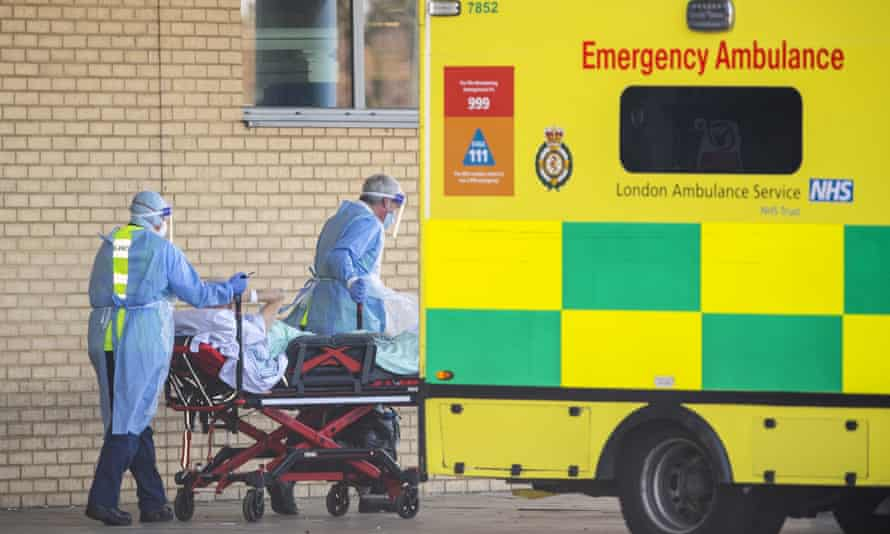 NHS workers take a patient into hospital