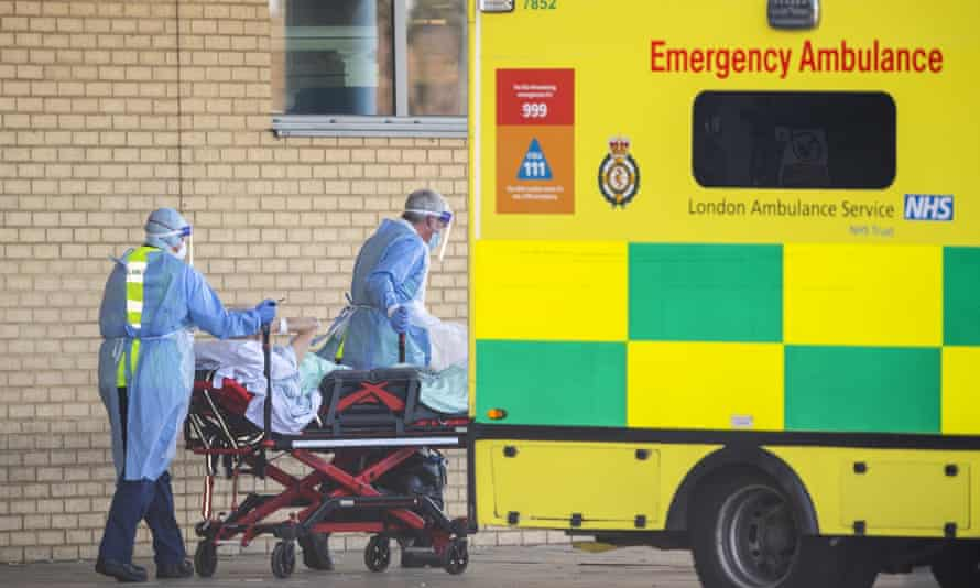 NHS emergency workers take a patient to hospital