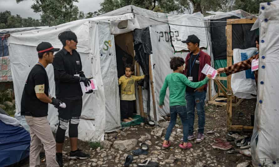 Distributing coronvirus awareness flyers to residents of the Moria refugee camp