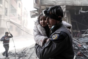 A member of the Syrian Civil Defence volunteers, also known as the White Helmets, in the rebel-held town of Douma.