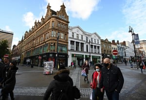 Shoppers walk at a near-deserted city centre in Leeds, Yorkshire on 31 October, 2020, as the number of cases of the novel coronavirus COVID-19 rises.