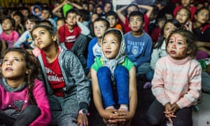 Children watch a cartoon at the Moria camp in Lesbos