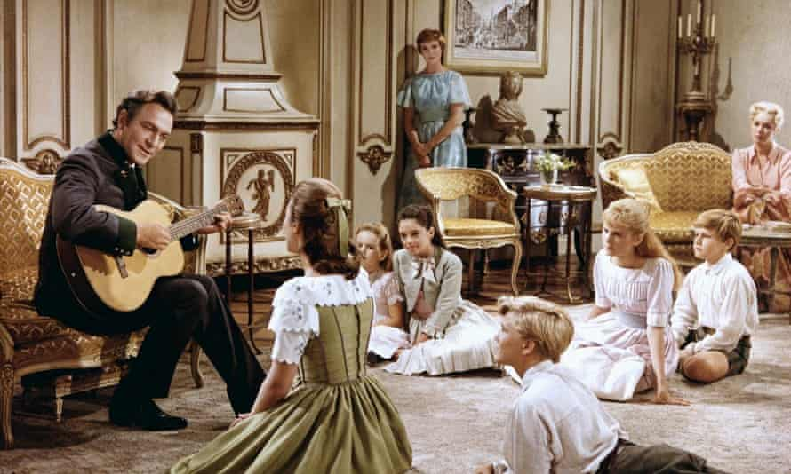 Plummer, left, with Julie Andrews (standing) in The Sound of Music.