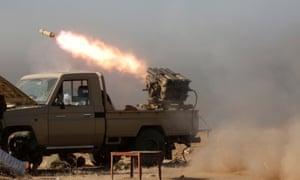 Peshmerga forces fire a Katyusha rocket launcher