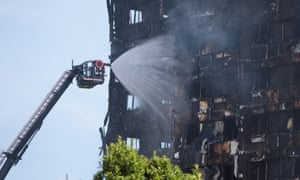 Firefighters spray water on to Grenfell Tower in Latimer Road, west London.