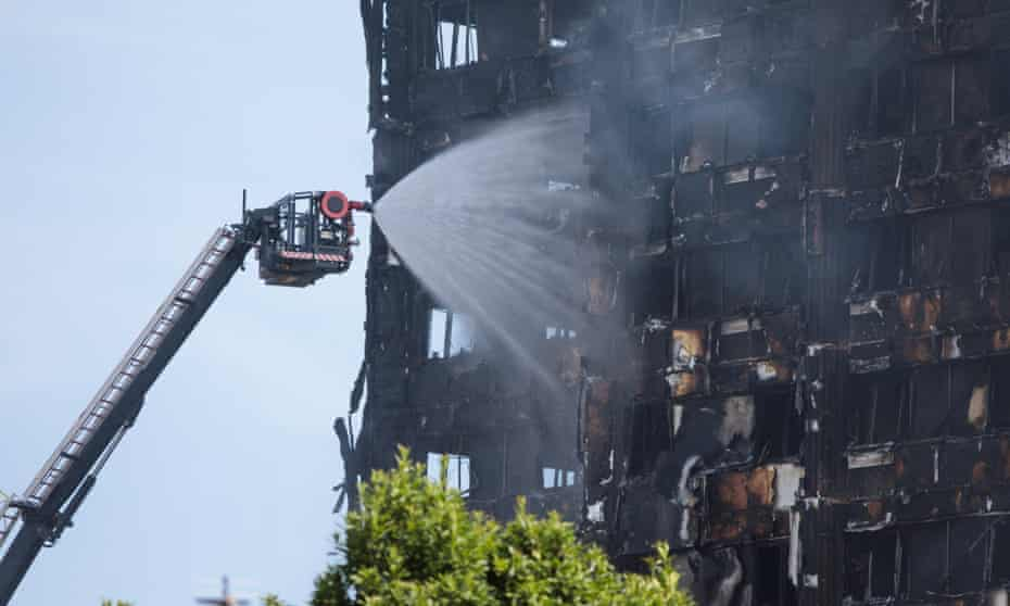 Grenfell Tower smoulders after a fire ripped through the building in west London.