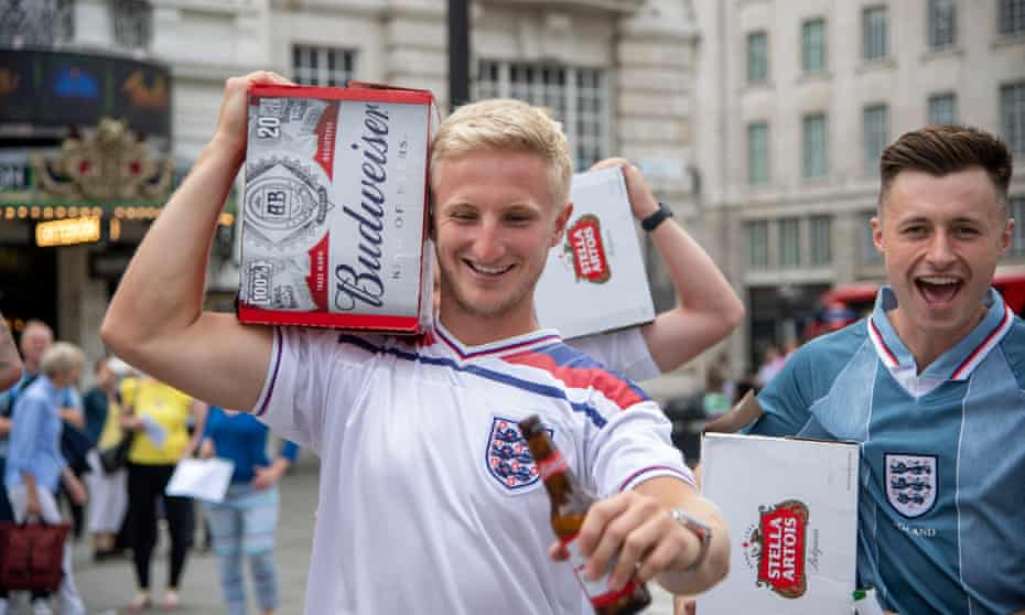 England fans carrying cases of beer