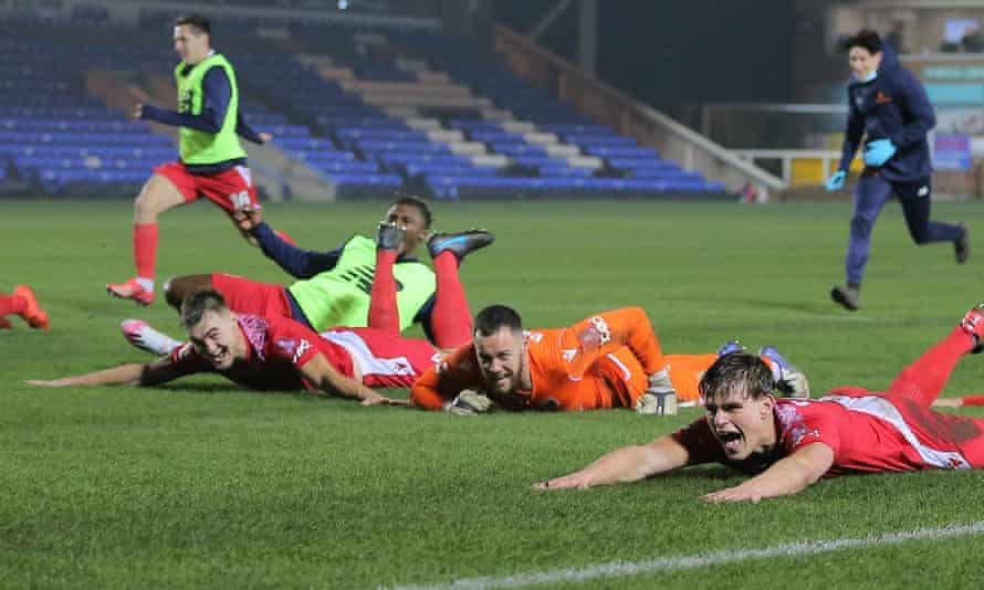 Chorley's players celebrate after dumping Peterborough out of the FA Cup.