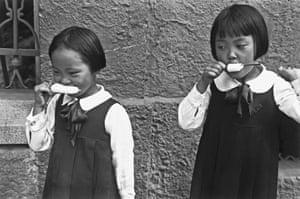Brazilian-Japanese children enjoy an ice cream