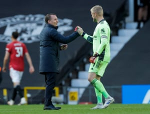 Leicester City manager Brendan Rogers celebrates the Foxes' win with keeper Kasper Schmeichel.