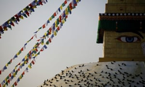 Pigeons rest on the Boudhanath stupa.